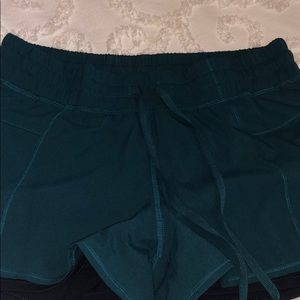 Dark teal athletic shorts